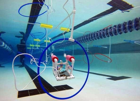 SeaPerch robot going through hoop in pool