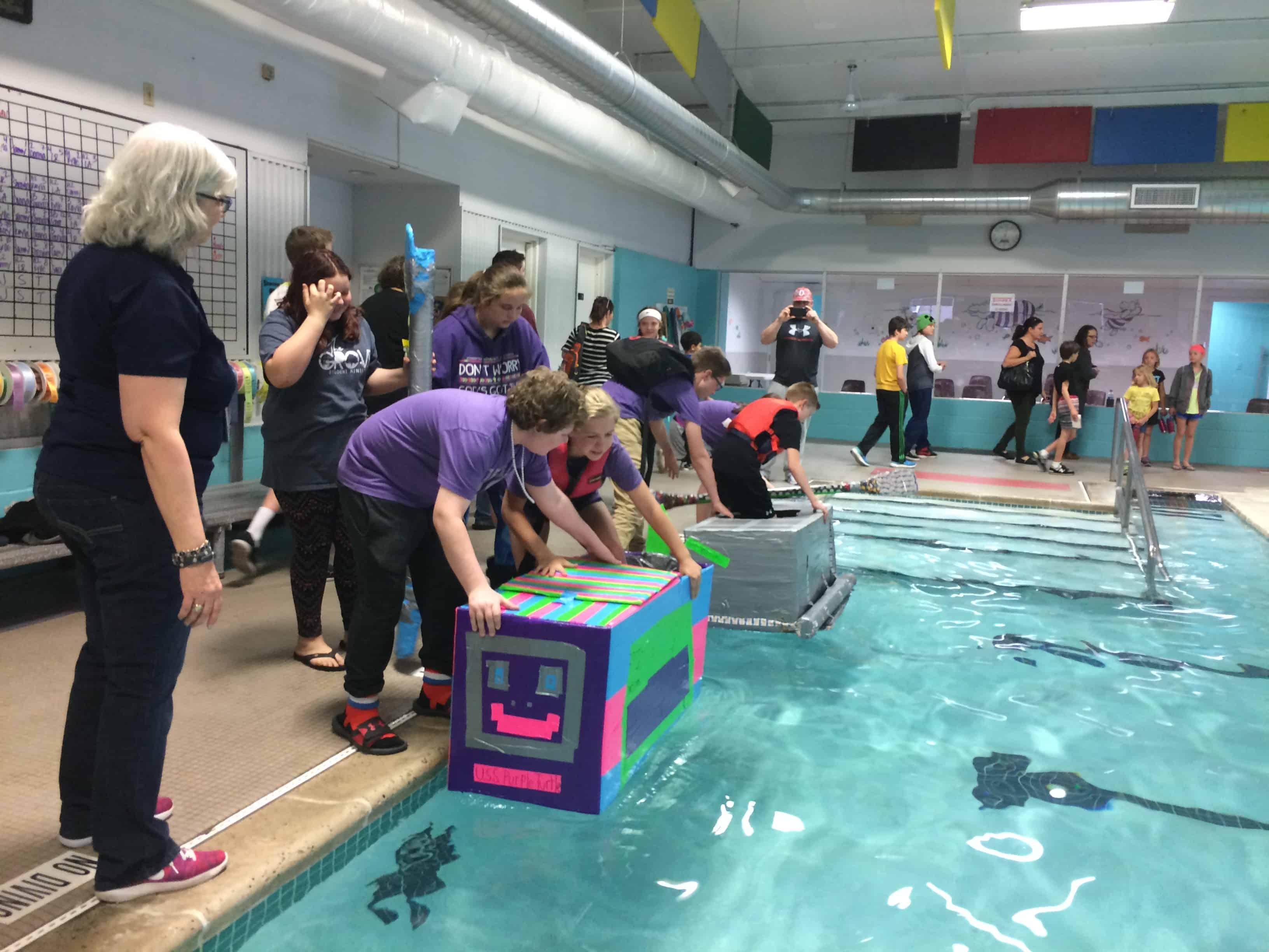 Students prepare to enter their boats in the 2017 Cardboard and Duct Tape Boat Regatta