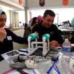 Teachers assemble SeaPerch robots