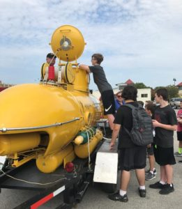 Students peer into yellow submarine during 2017 STEM Expo day