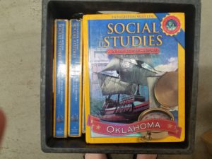 Photo of Oklahoma social studies textbook with ship and compass on cover