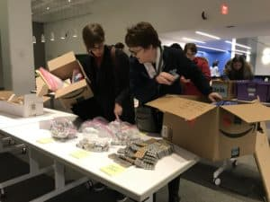 teachers fill boxes with batteries during STEM Shoppe Open House