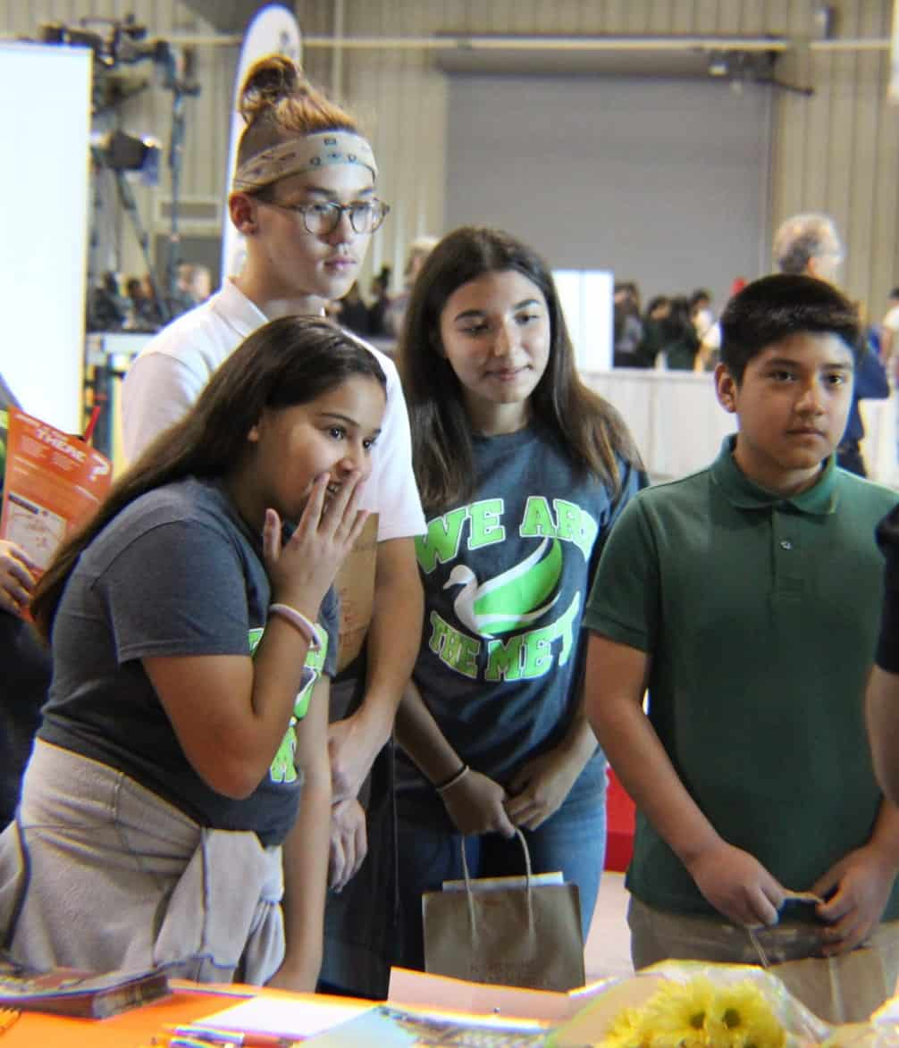 Four students react to science experiment at the Flight Night Back to School STEM Expo.